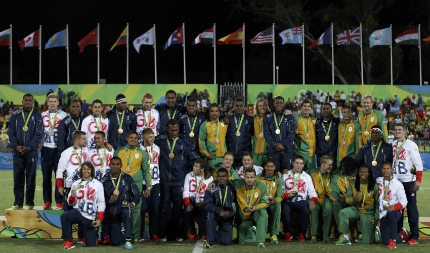 2016 Rio Olympics - Rugby - Men's Victory Ceremony - Deodoro Stadium - Rio de Janeiro, Brazil - 11/08/2016. Players from Britain, Fiji and South Africa pose for photos at the victory ceremony.